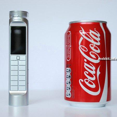 Мобильный телефон на кока-коле