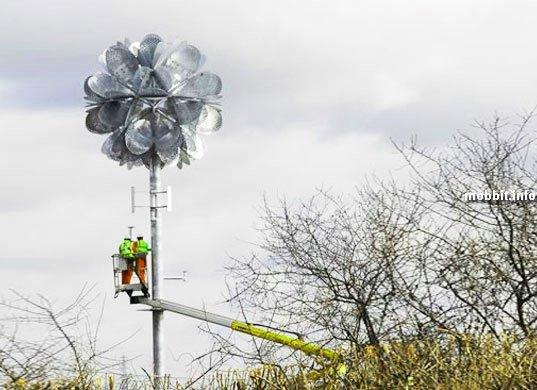 Огромный металлический  LED-цветок на ветряных турбинах