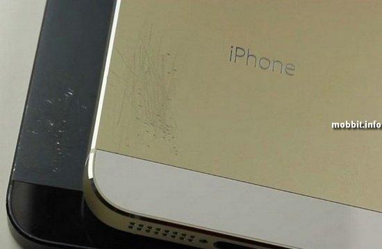 Тест на устойчивость к механическим повреждениям золотистого iPhone 5S